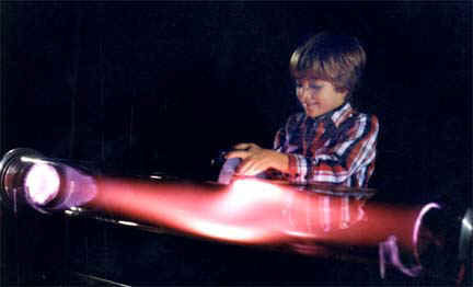 "Playing with a magnet and a plasma discharge tube, the ""Aurora Borealis Tube Display,"" by Resonance Research Corporation."